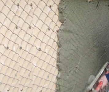 Chain link fence used as plastering mesh
